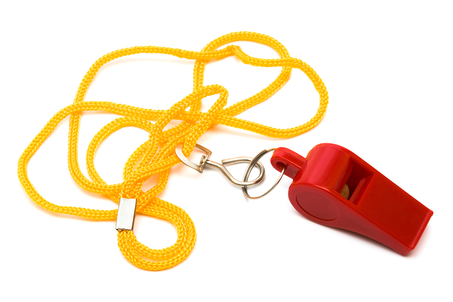 Beautiful red whistle on a yellow cord